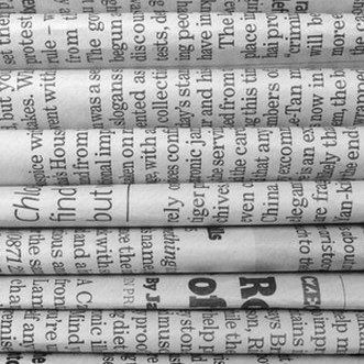 Stack of black and white newspapers
